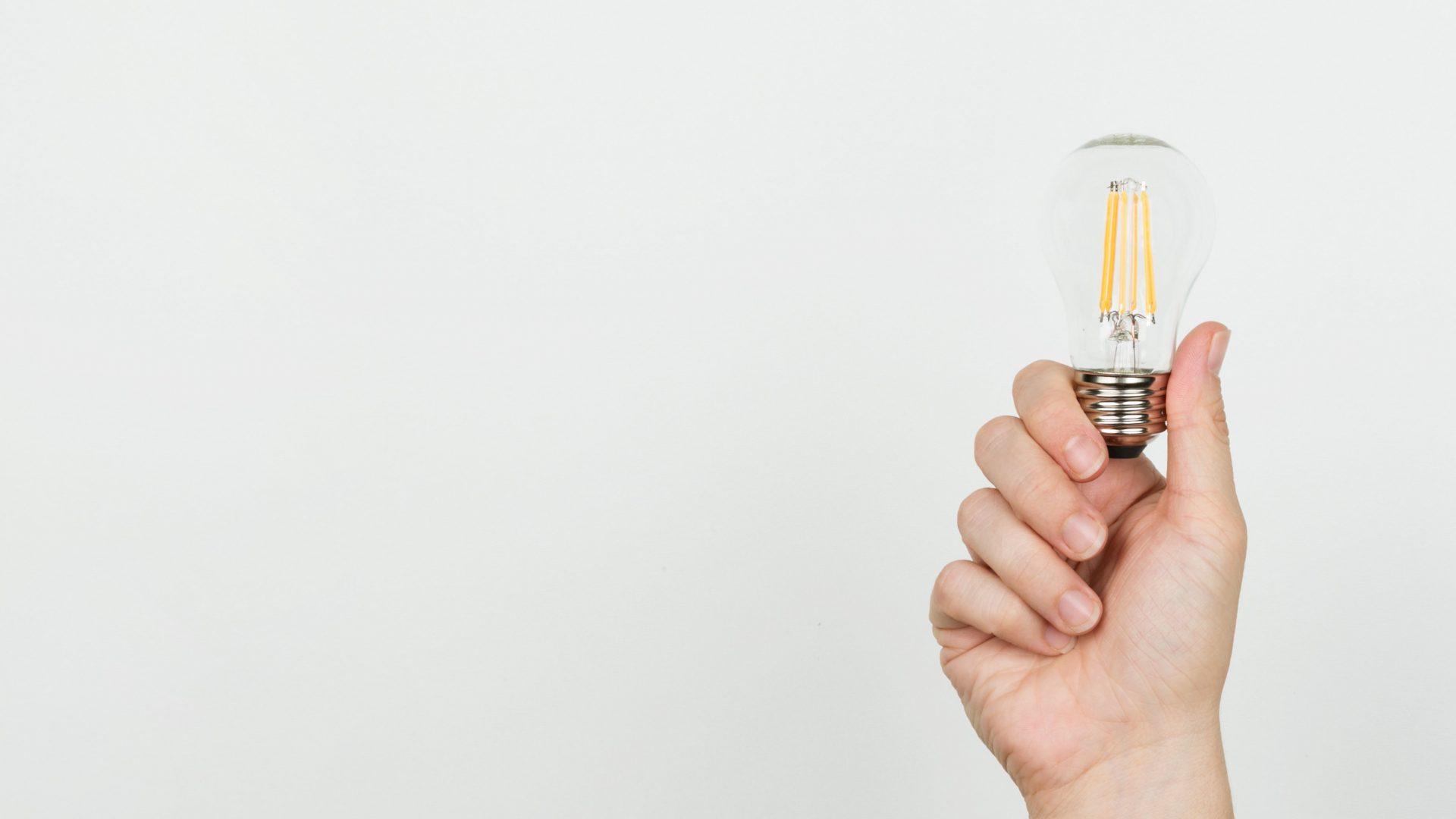 Coapt maintenance team - hand holding lightbulb